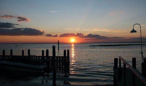 Jetsetter Guides water sky outdoor scene pier Sunset horizon Sea sunrise Ocean afterglow Coast dawn dusk evening shore morning Beach bay overlooking distance