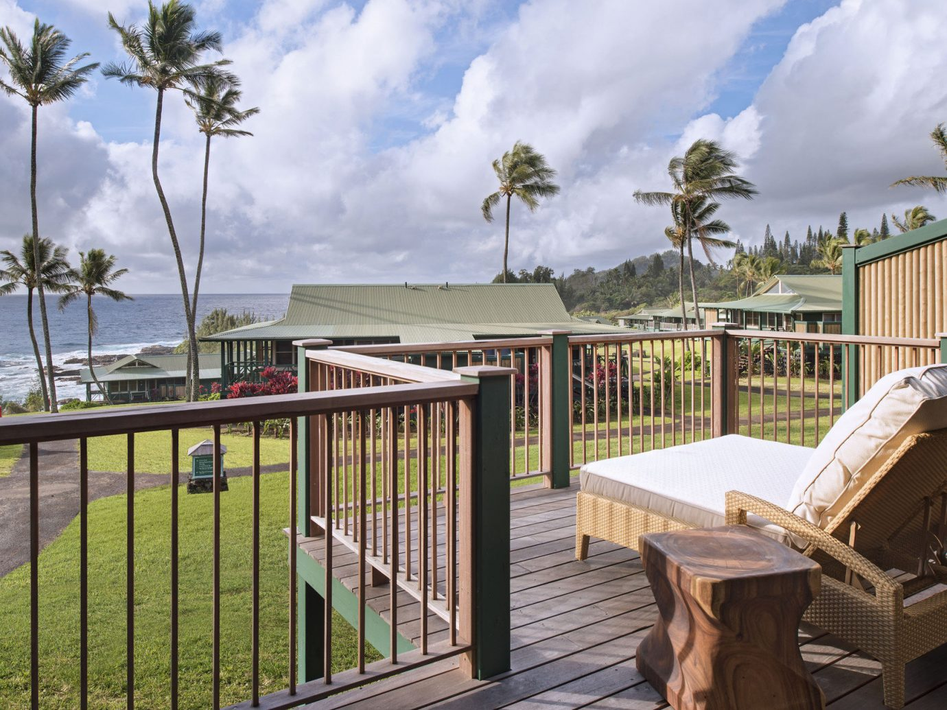 Balcony Beach Boutique Hotels Buildings Exterior Hotels isolation lounge chairs Luxury Travel Ocean ocean view palm trees Patio private remote Terrace Tropical view Fence sky outdoor property home vacation house real estate estate outdoor structure Deck cottage backyard Villa railing overlooking