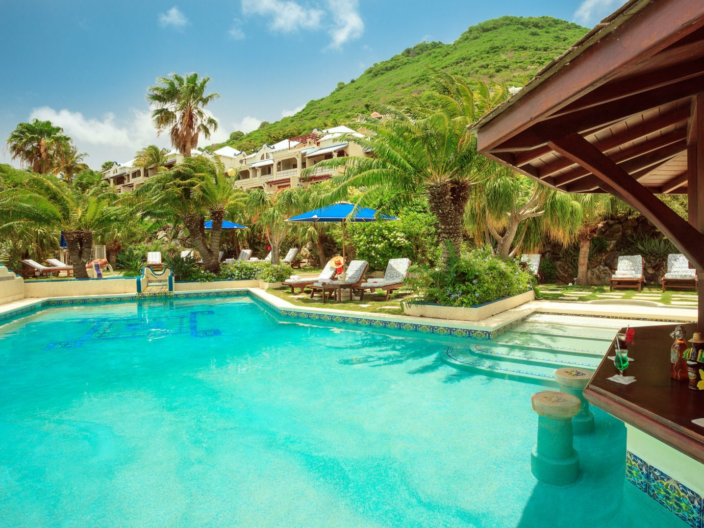 Hotels sky outdoor Resort swimming pool leisure property resort town Pool estate vacation water real estate palm tree Villa arecales tropics caribbean tree tourism blue Lagoon hotel bay swimming