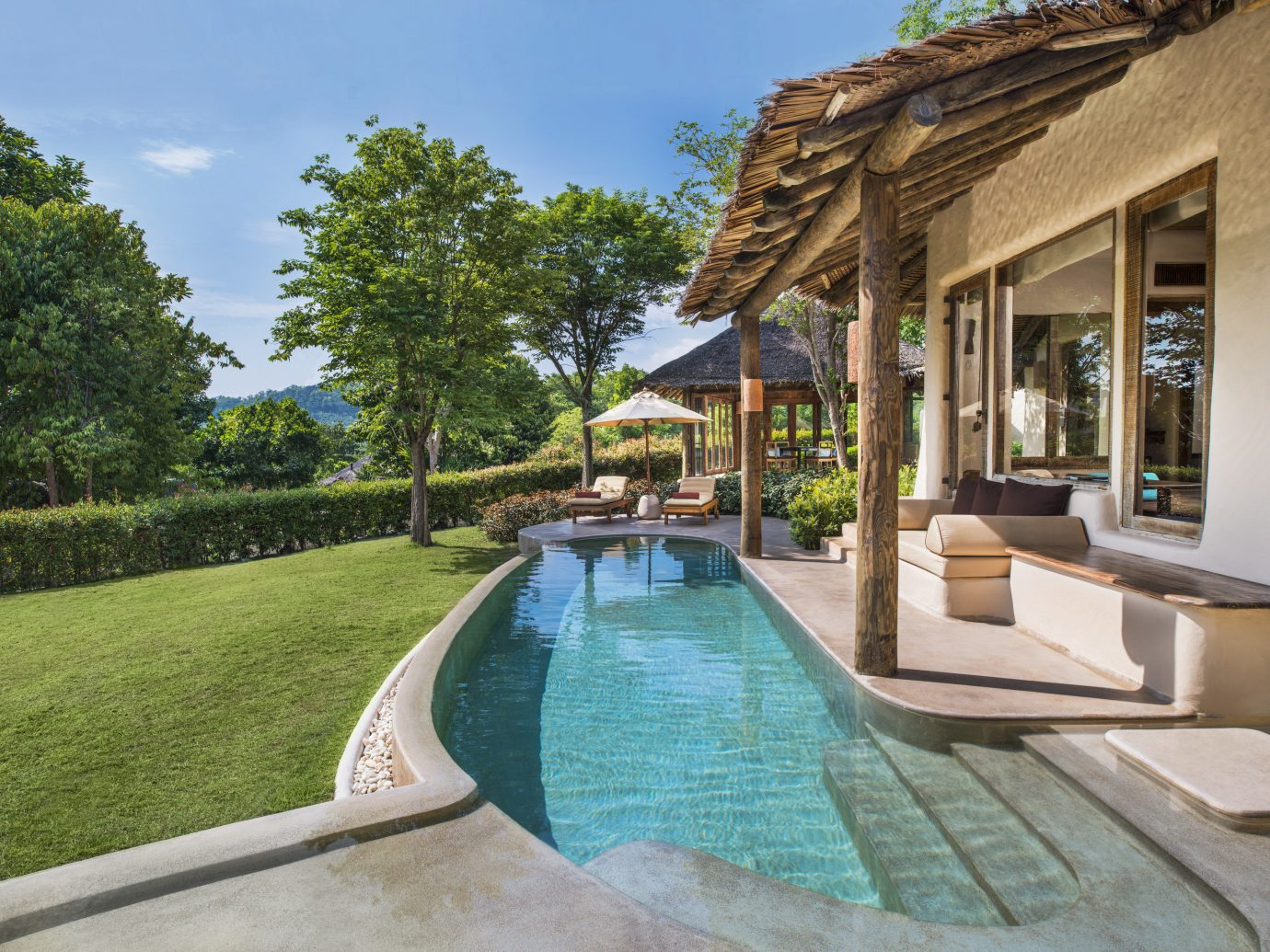 Beach Hotels Phuket Thailand property swimming pool estate Resort real estate Villa home leisure house hacienda backyard cottage amenity