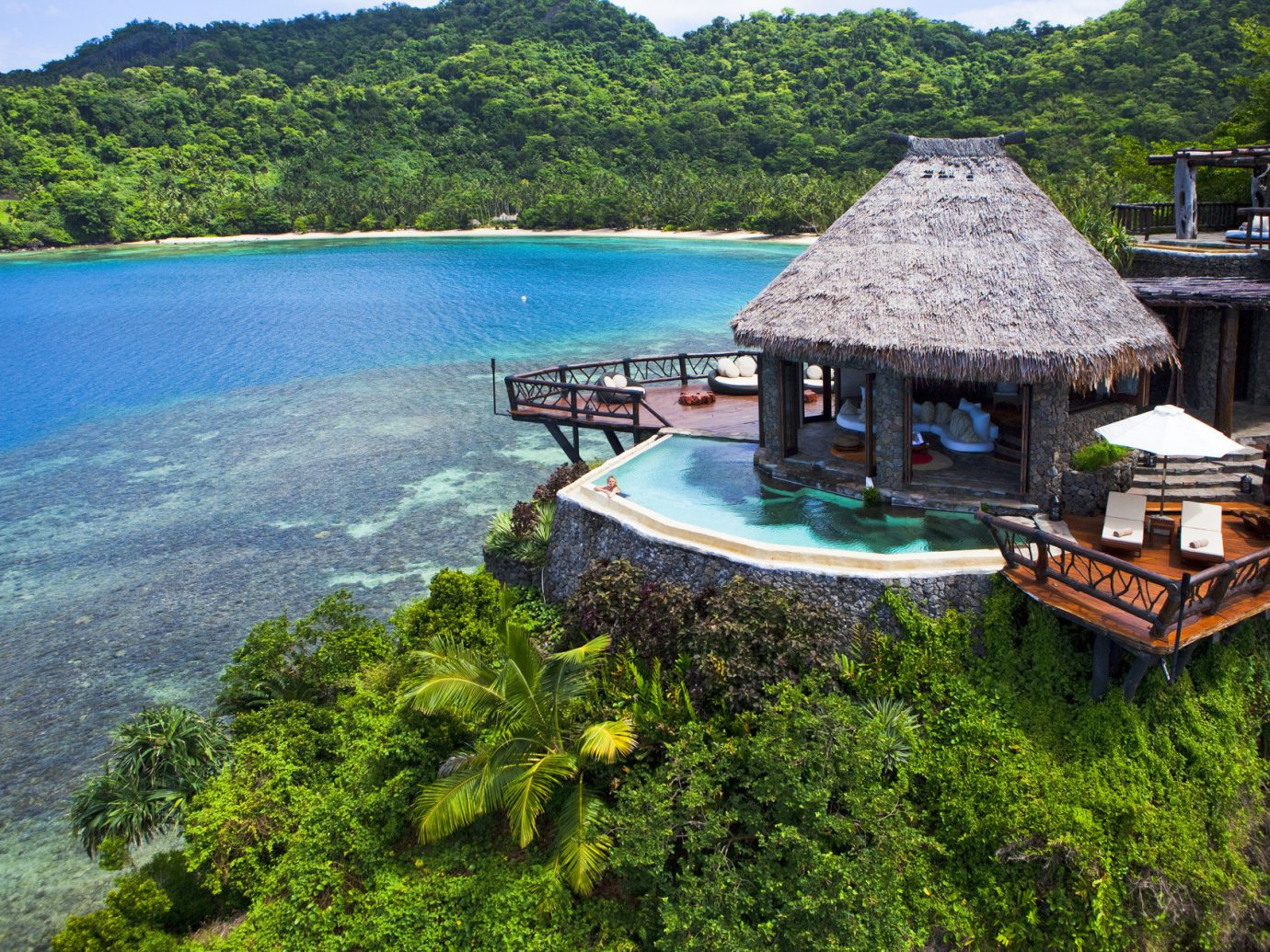 Beach clear water Greenery Hotels huts isolation Luxury Ocean private private pool quaint remote serene Tropical turquoise outdoor water sky Nature vacation tourism Sea Coast bay estate Resort Island Lake surrounded