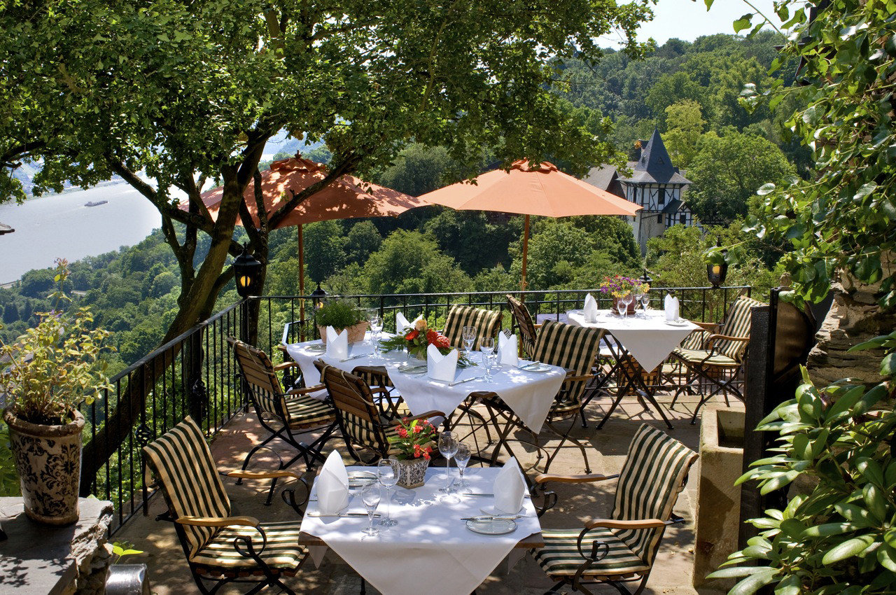 Hotels Landmarks Luxury Travel tree outdoor chair estate Resort Garden backyard Dining flower set furniture area decorated surrounded several