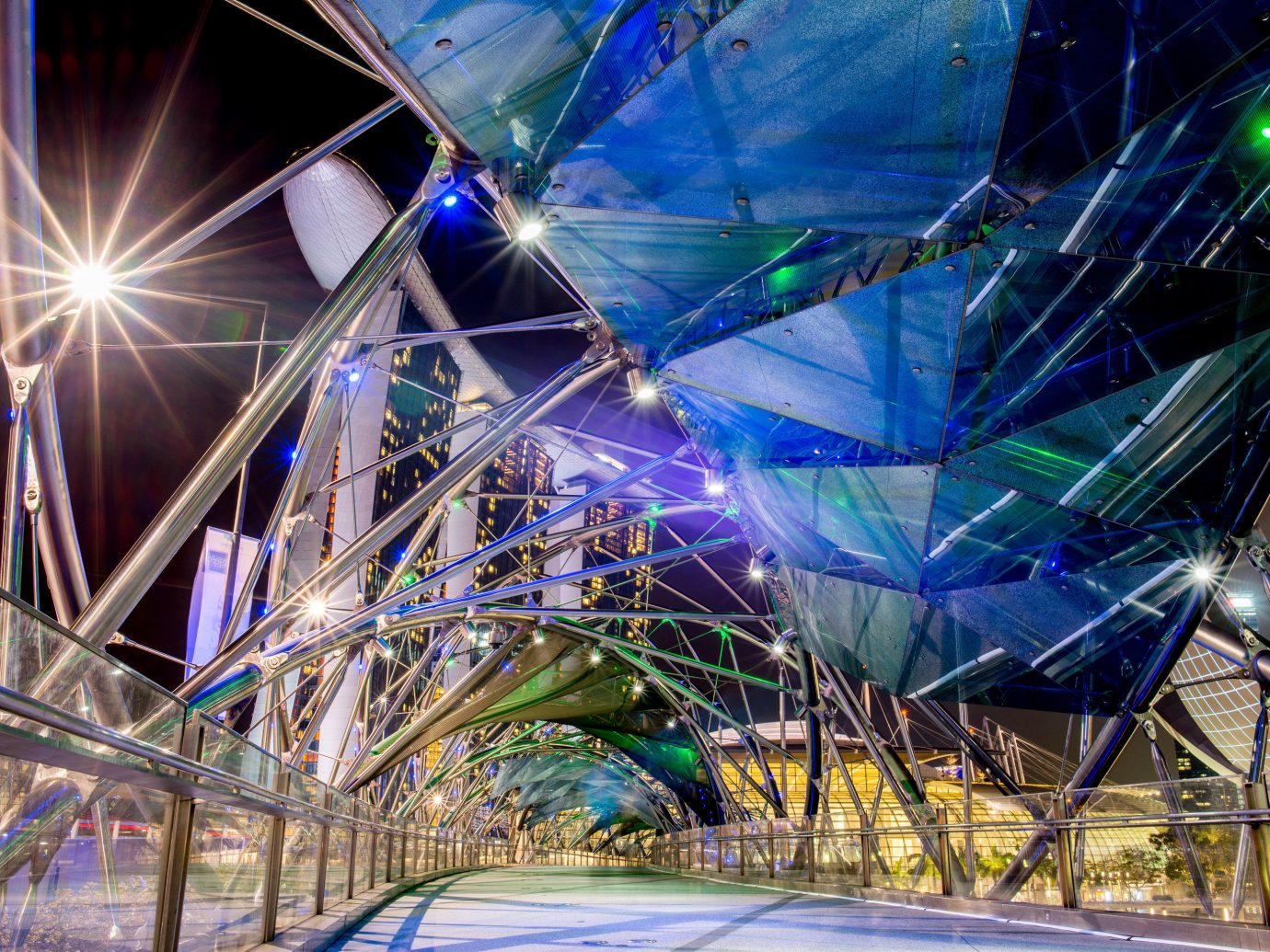 Offbeat Singapore Trip Ideas color blue light night ferris wheel atmosphere of earth tourist attraction reflection amusement park colorful