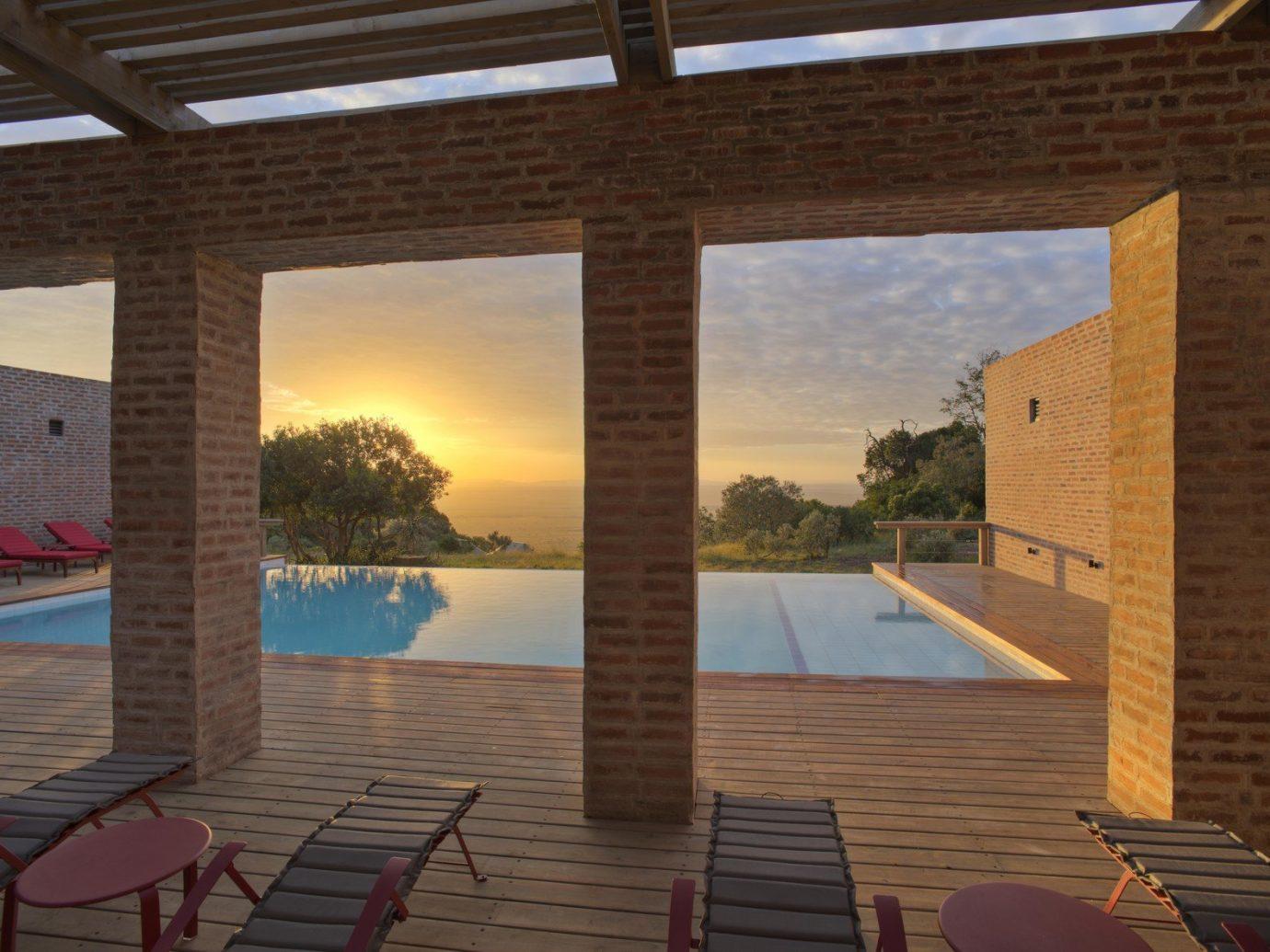 All-Inclusive Resorts Hotels Romantic Hotels property building Architecture estate swimming pool Villa Resort interior design hacienda outdoor structure cottage