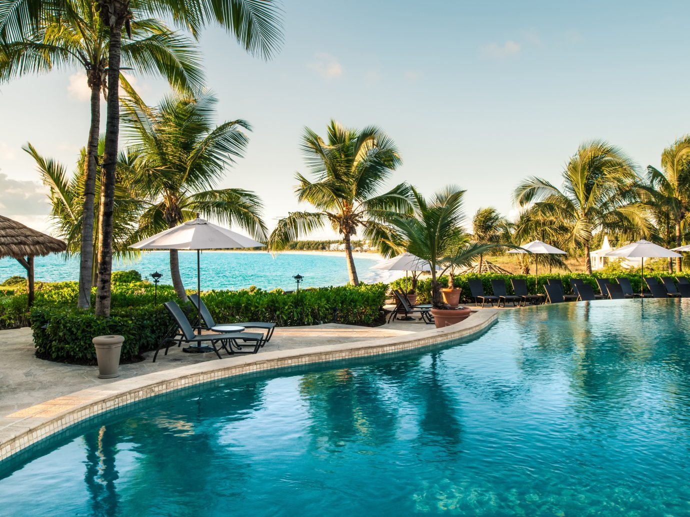 Honeymoon Hotels Pool Resort Romance Wellness outdoor tree water sky palm Beach swimming pool property leisure vacation estate caribbean arecales resort town Lagoon tropics bay Villa Lake lined swimming plant empty sandy surrounded