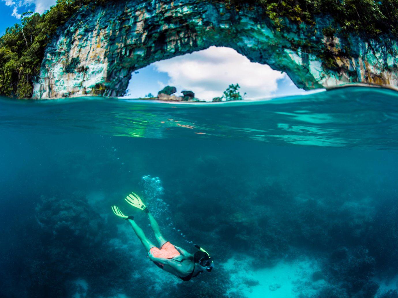 Islands Trip Ideas water Sport Nature outdoor person water sport underwater Sea freediving marine biology Ocean underwater diving Lagoon snorkeling blue wave diving swimming