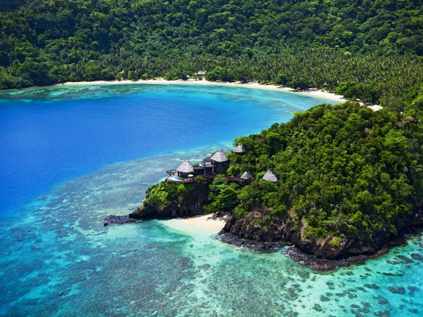 Beach clear water Greenery Hotels isolation Luxury Travel Ocean quaint remote serene Tropical turquoise white sands water tree outdoor Nature reef geographical feature landform Lake body of water River archipelago Sea Coast pond bay islet Lagoon Island floating tropics caribbean cove cape shore surrounded swimming