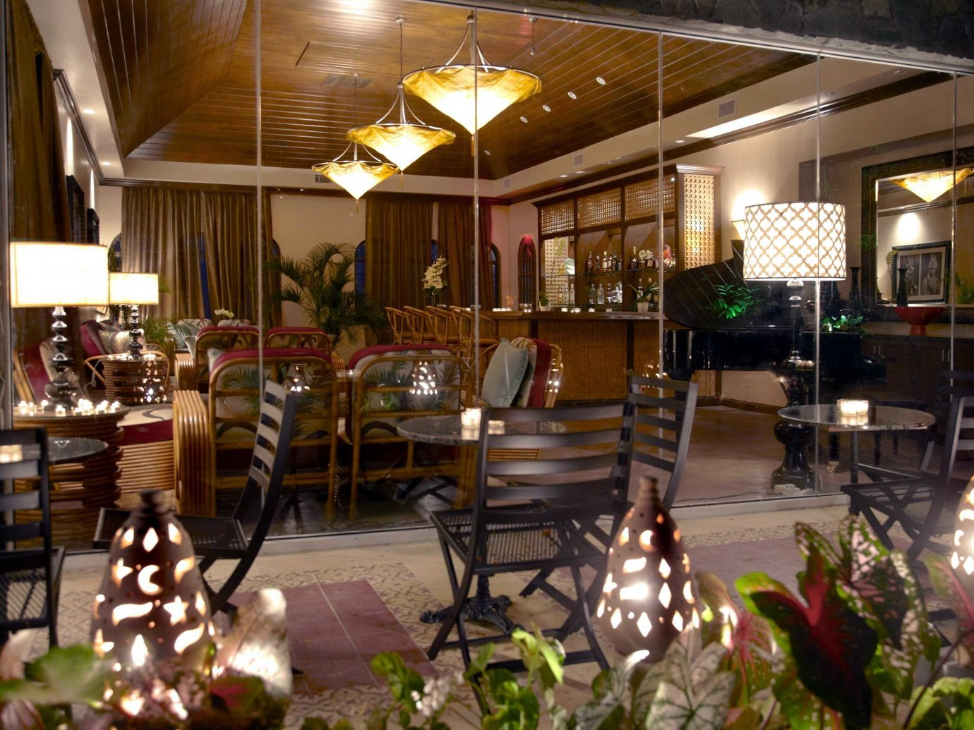 All-Inclusive Resorts Bar caribbean Dining Drink Eat Hip Scenic views Tropical indoor table ceiling meal room restaurant Lobby lighting interior design Resort furniture