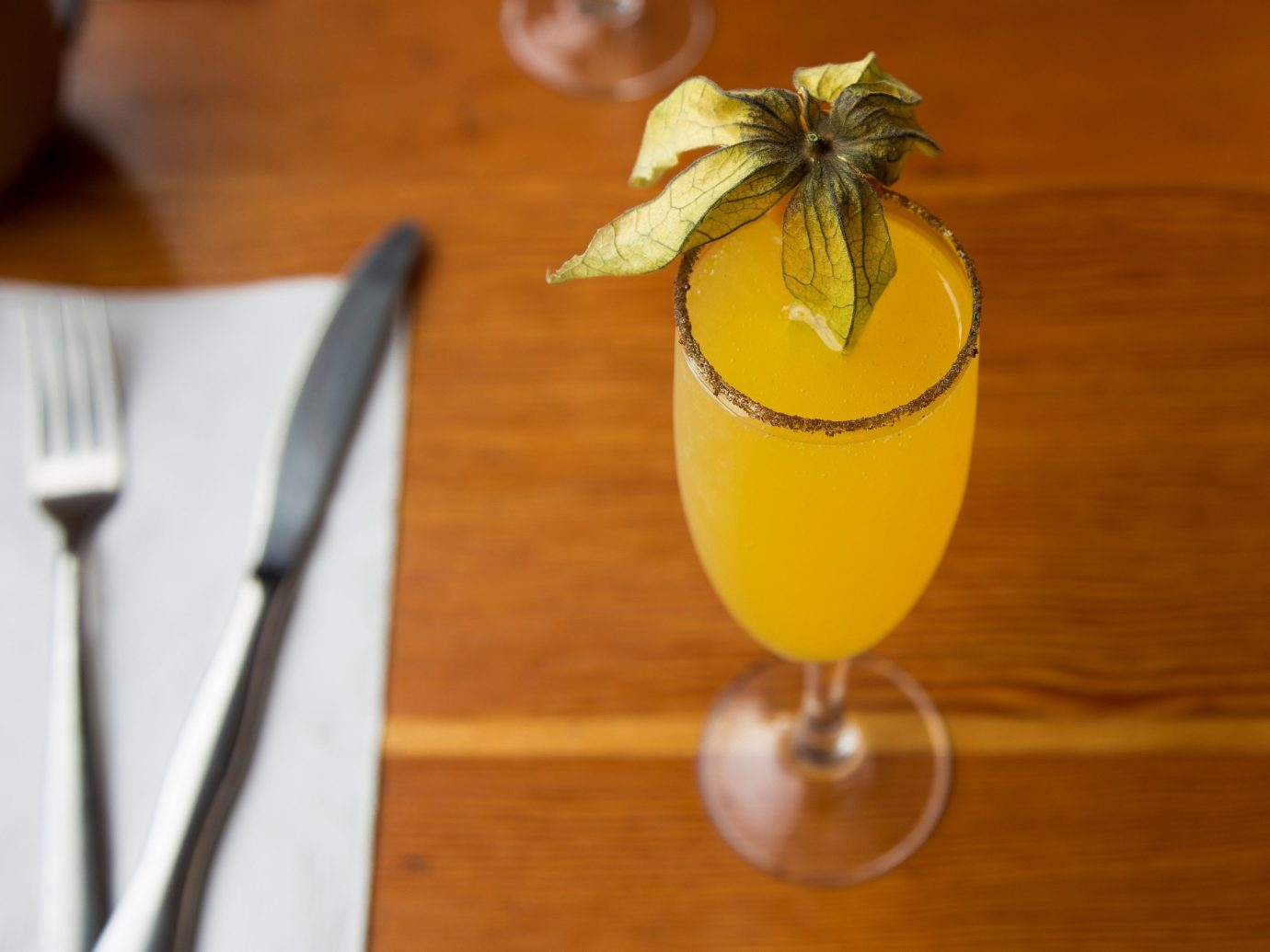 Food + Drink Hotels Luxury Travel table indoor Drink alcoholic beverage cocktail plant produce land plant wooden food liqueur distilled beverage mai tai flowering plant fruit