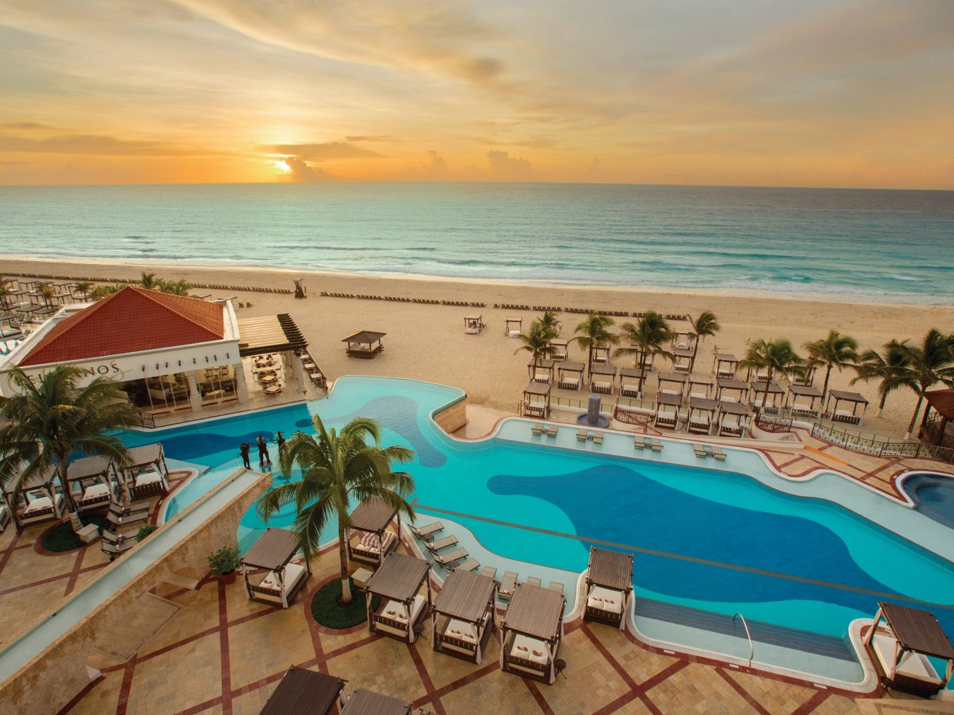 Hotels sky outdoor water Beach ground Resort Sea swimming pool leisure vacation caribbean Ocean tourism horizon resort town lawn real estate coastal and oceanic landforms tropics hotel recreation palm tree shore sand lined sandy