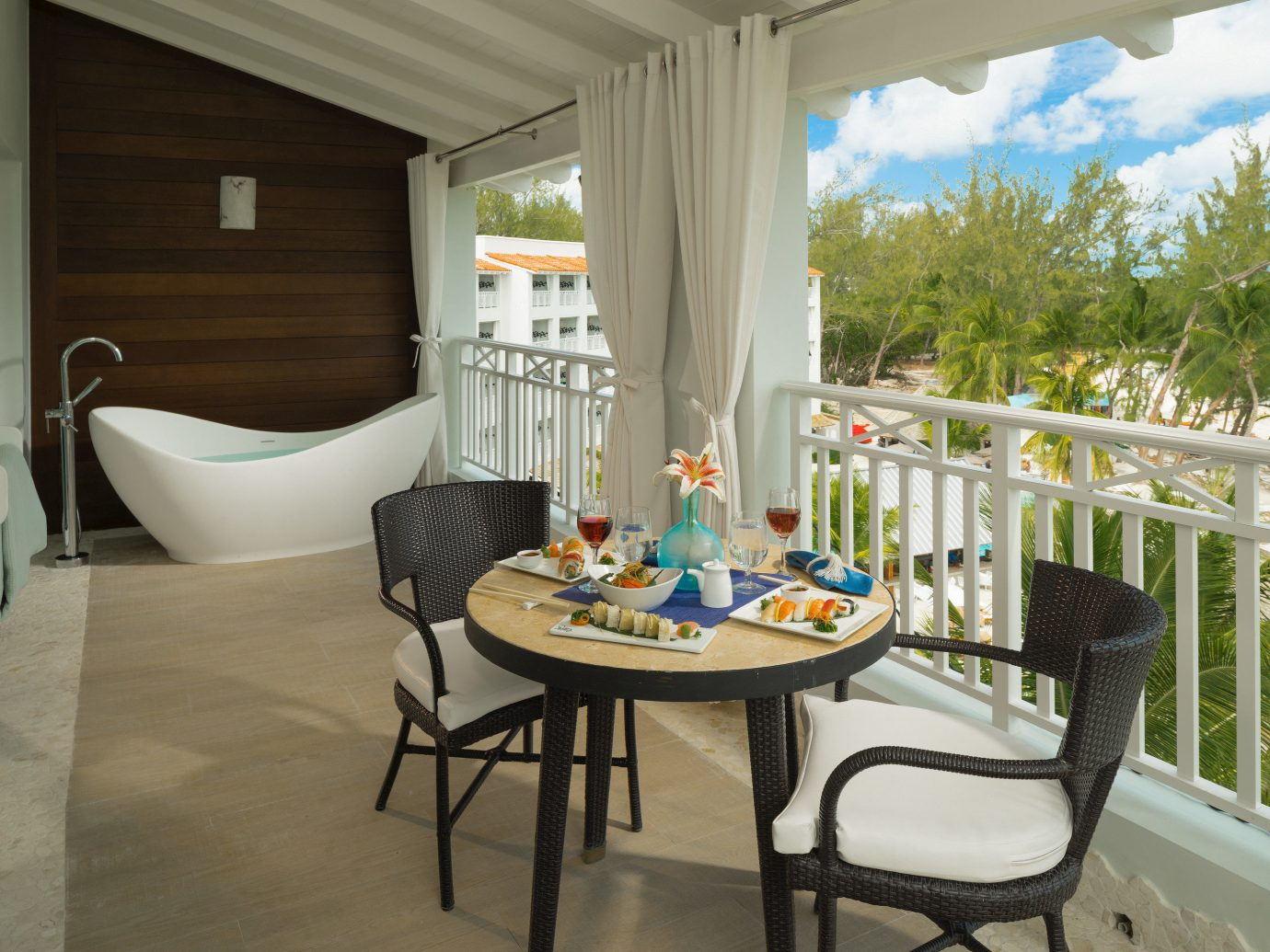 All-Inclusive Resorts Hotels floor chair indoor property window table interior design home real estate Balcony house porch estate outdoor structure furniture apartment Patio dining room living room