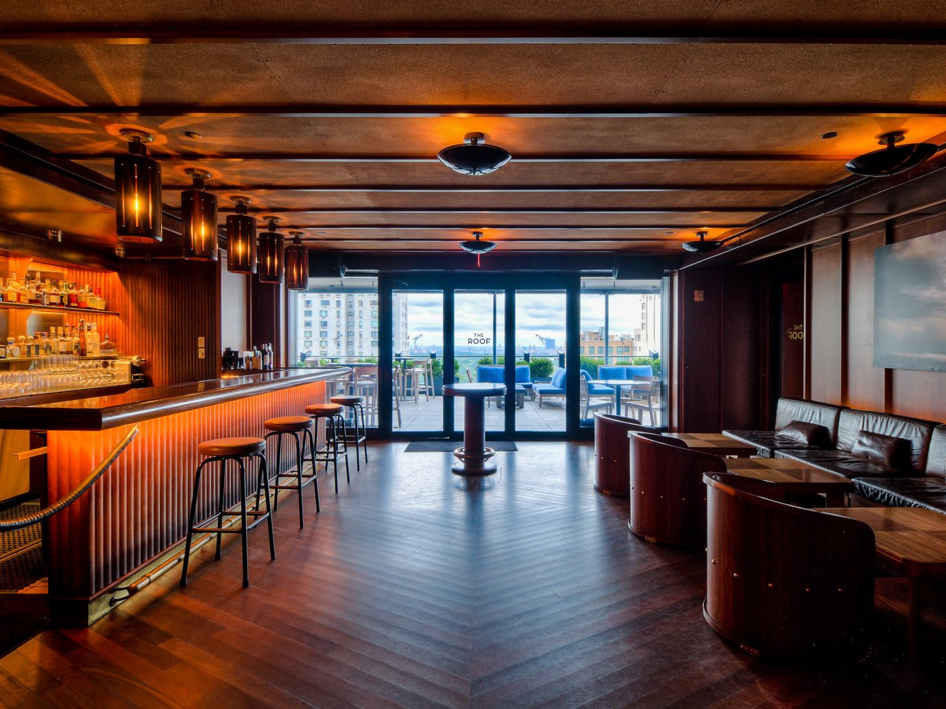 Boutique Hotels Food + Drink Hotels floor indoor ceiling table room restaurant interior design wood Bar wooden real estate Dining long furniture empty area several