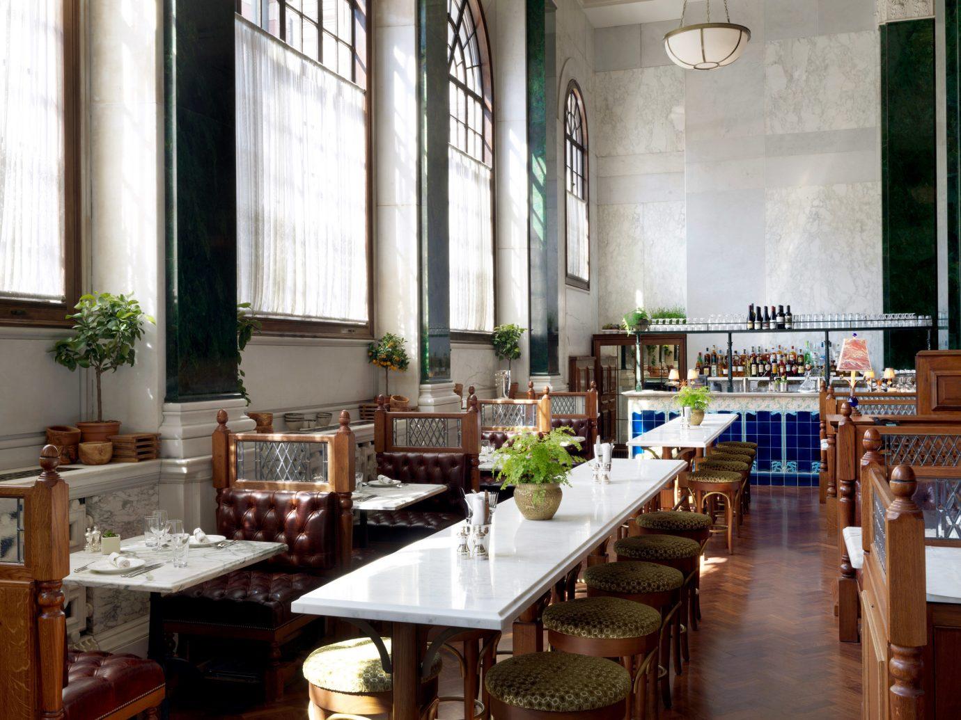 table indoor floor window room restaurant meal estate interior design counter furniture dining room
