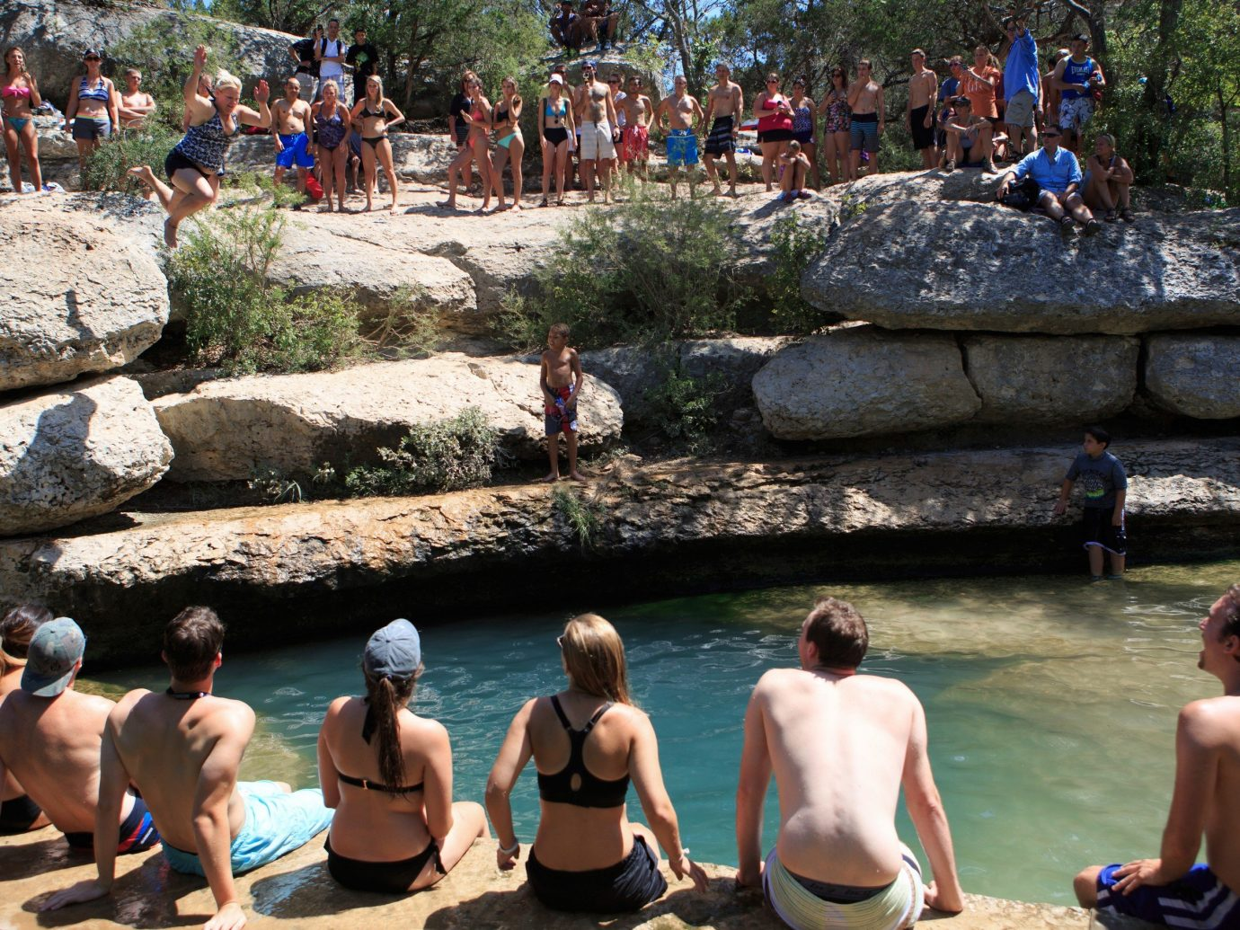 Outdoors + Adventure outdoor rock ground person people group tourism vacation physical fitness swimming stone crowd Raft several