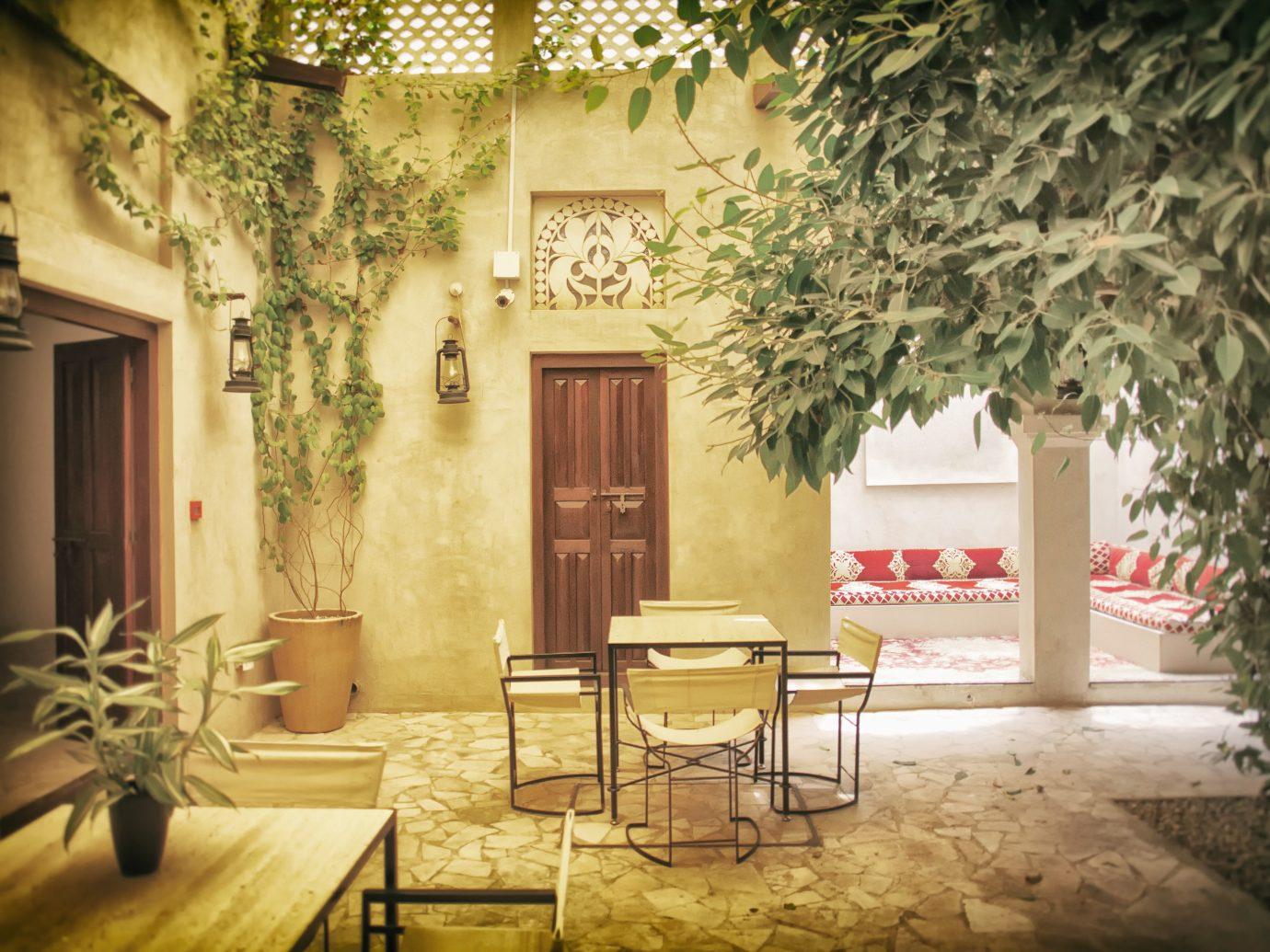 Dubai Hotels Luxury Travel Middle East interior design home Courtyard Lobby window tree estate hacienda house