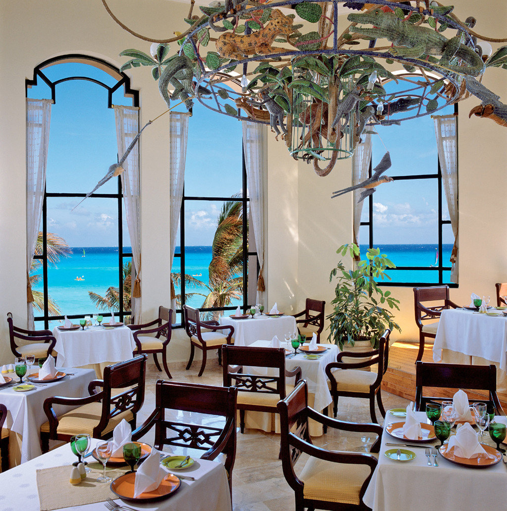 All-Inclusive Resorts Balcony Beachfront Dining Drink Eat Elegant Hotels Luxury Travel Romance Scenic views indoor Living room restaurant estate home interior design Resort Party meal dining room furniture centrepiece decorated several