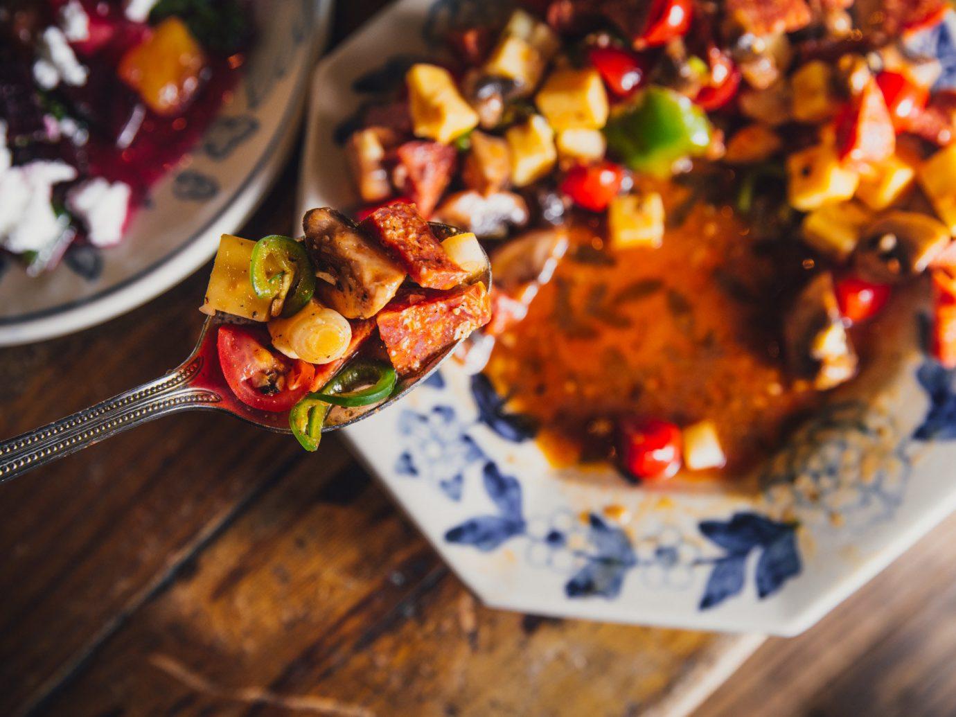 Food + Drink indoor dish food cuisine vegetarian food nachos vegetable meal recipe brunch side dish breakfast toppings