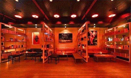 Food + Drink ceiling indoor floor room stage recreation room billiard room function hall nightclub theatre auditorium Bar wood furniture