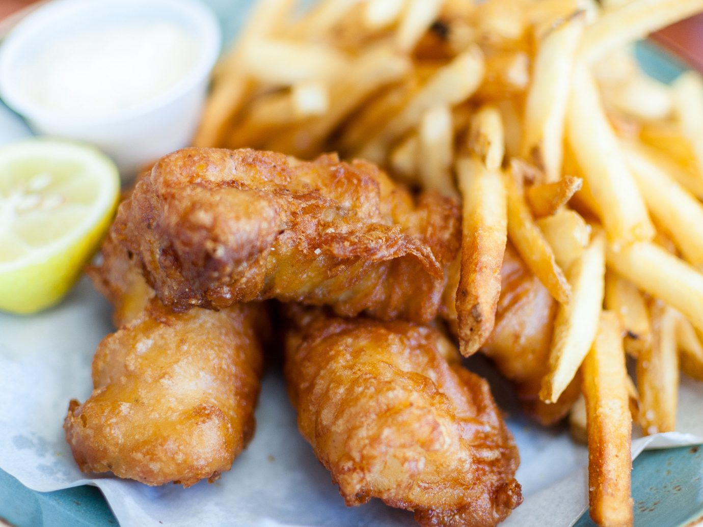 Jetsetter Guides Road Trips Trip Ideas food plate dish fried food meat french fries cuisine fish meal fish and chips fries fast food chicken meat asian food thai food chicken fingers produce satay