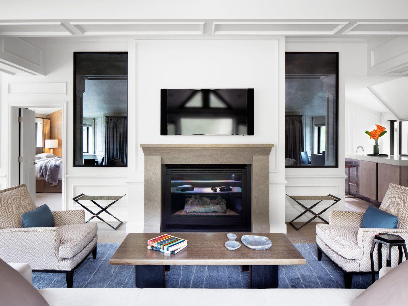 Celebs Hotels Trip Ideas living room indoor floor room Living window furniture home interior design Design Fireplace table