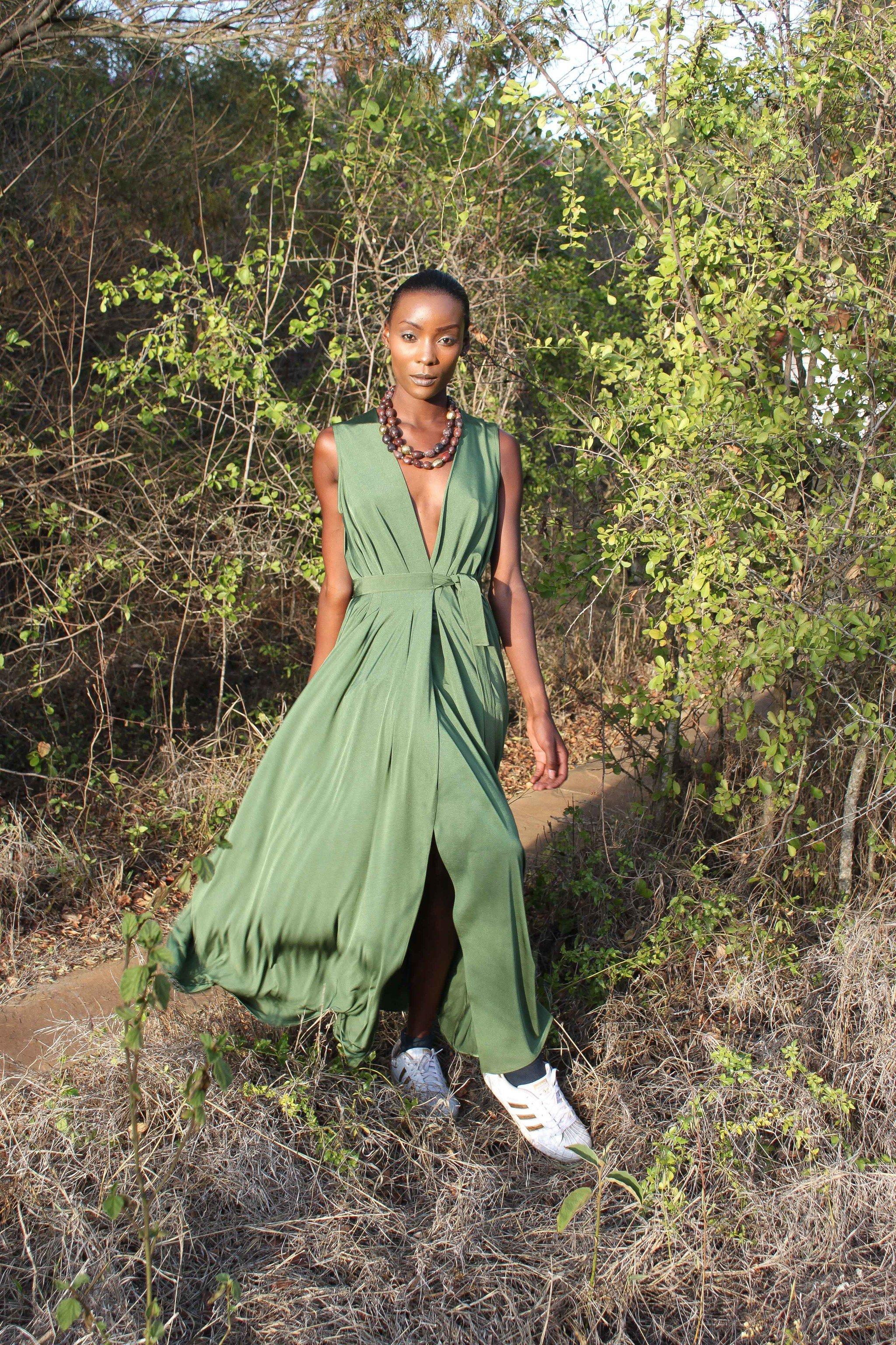 shopping Style + Design Travel Trends Trip Ideas tree outdoor person clothing green man dress girl standing fashion plant grass Jungle photo shoot model Forest grass family wood posing wooded