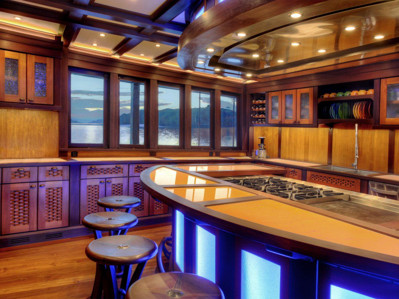 Luxury Travel Trip Ideas indoor ceiling floor interior design lighting recreation room wood restaurant estate countertop Bar