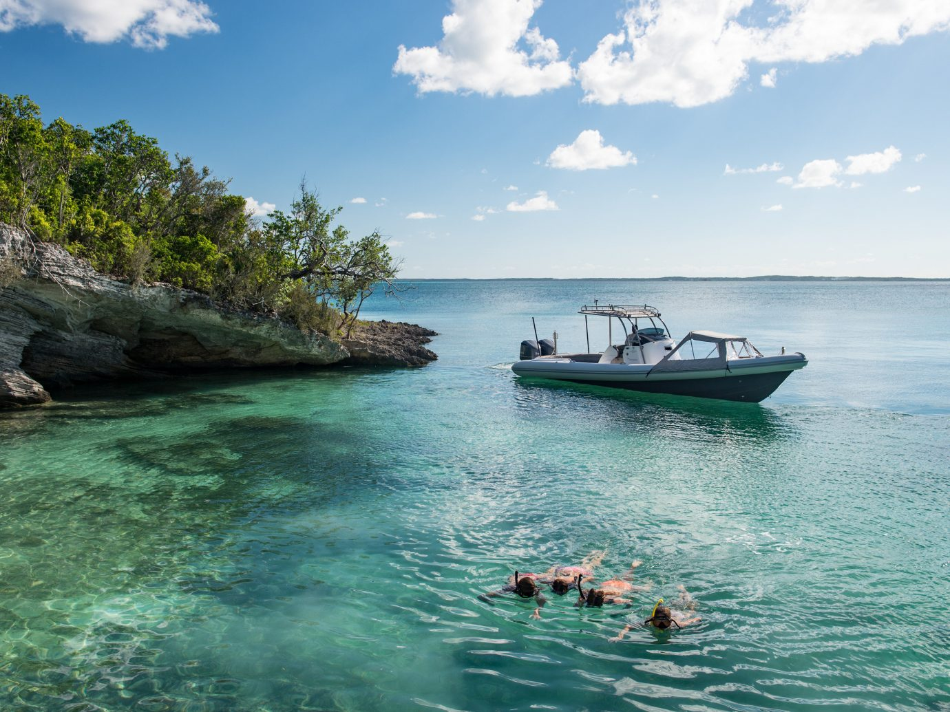 Bahamas Trip Ideas water sky outdoor Sea Boat body of water coastal and oceanic landforms Ocean Coast tropics bay Lagoon Island promontory tourism vacation islet Nature cloud caribbean tree cape Beach inlet landscape calm cove archipelago swimming day