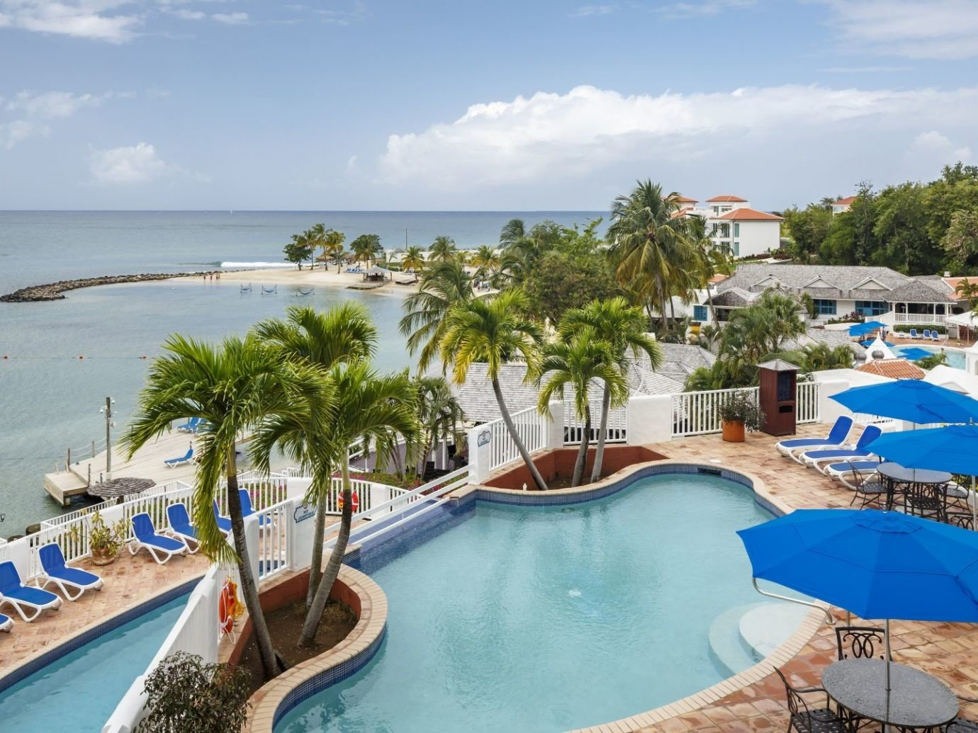 All-Inclusive Resorts Budget Hotels Resort property leisure swimming pool tourism real estate resort town vacation caribbean Sea palm tree bay coastal and oceanic landforms arecales tropics estate Coast Lagoon tree sky recreation