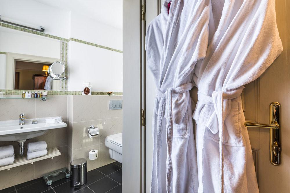 europe Hotels Prague indoor bathroom wall room interior design sink towel floor curtain window treatment