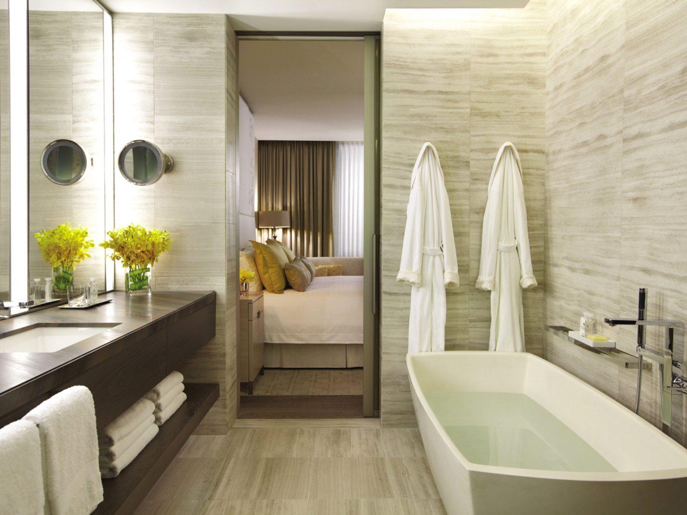 Bath Bedroom Canada Classic Hotels Living Luxury Resort Toronto indoor floor bathroom room property interior design home estate white bathtub Design Suite swimming pool wood tub