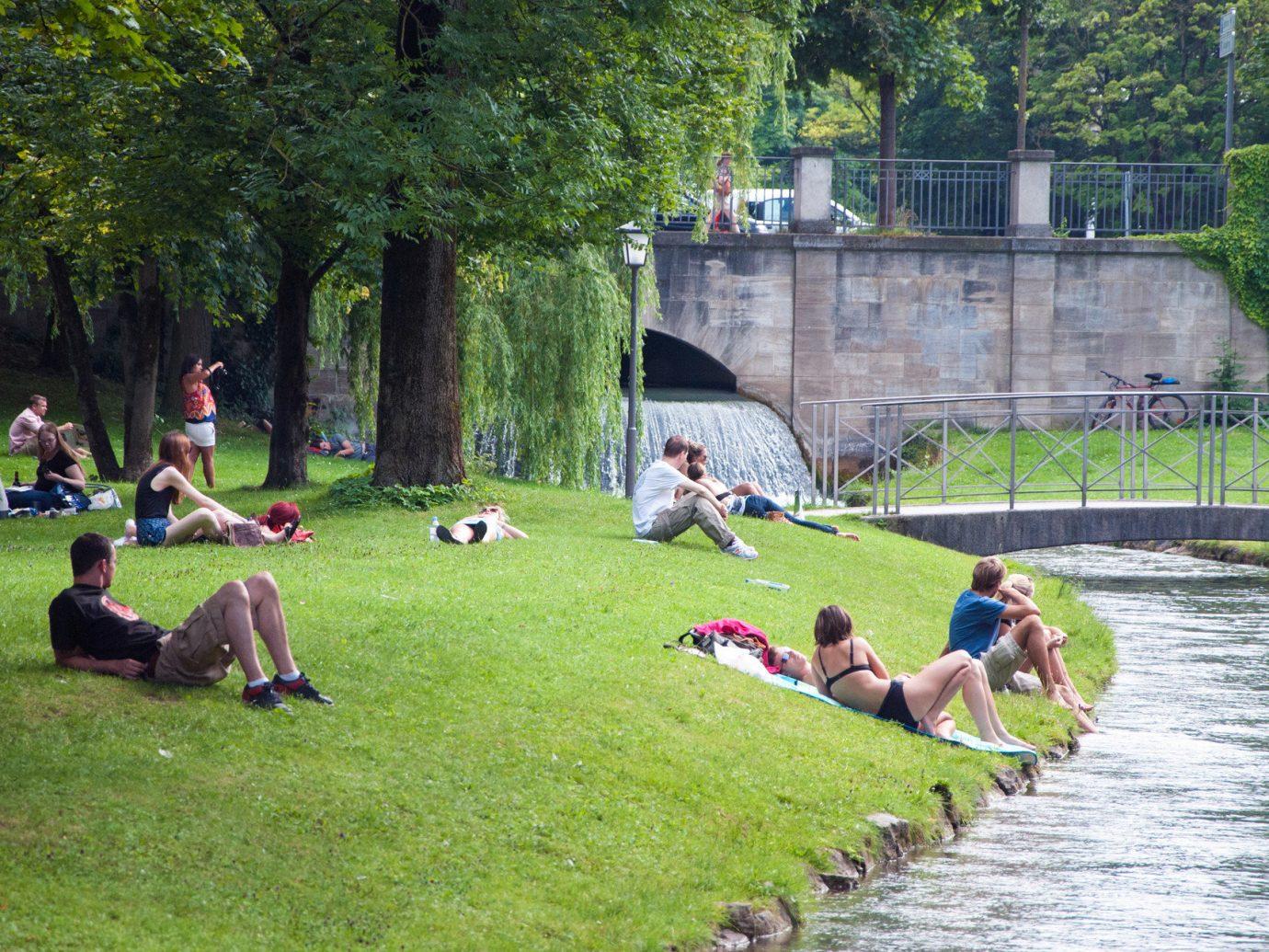 Berlin Germany Munich Trip Ideas tree grass outdoor leisure park group people waterway
