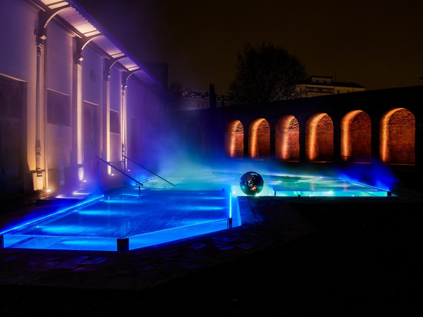 Arts + Culture Italy Milan water light lighting night reflection water feature fountain swimming pool darkness landscape lighting midnight theatrical scenery