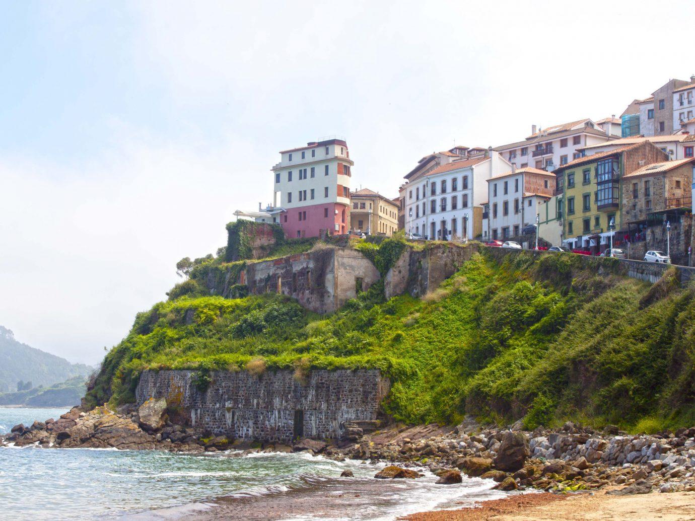 europe Spain Trip Ideas Coast Sea promontory water shore cliff sky terrain coastal and oceanic landforms building tree headland rock house bay City