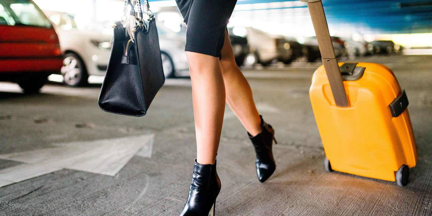Travel Shop Travel Tech person footwear outdoor yellow leg human leg joint shoe shoulder thigh vehicle calf jeans shorts girl abdomen knee Hip way