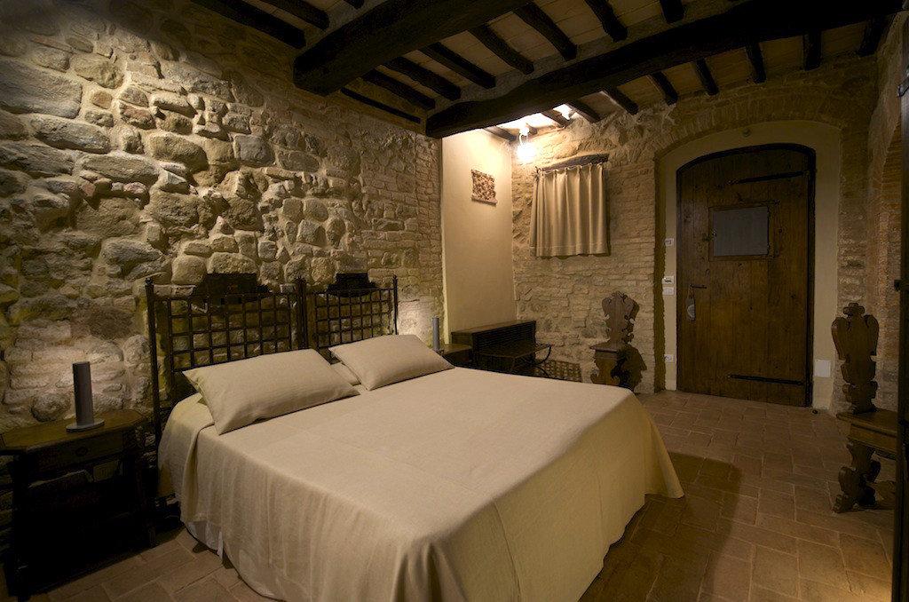 europe Hotels Italy Romance bed indoor wall floor room Bedroom ceiling hotel interior design Suite brick estate stone