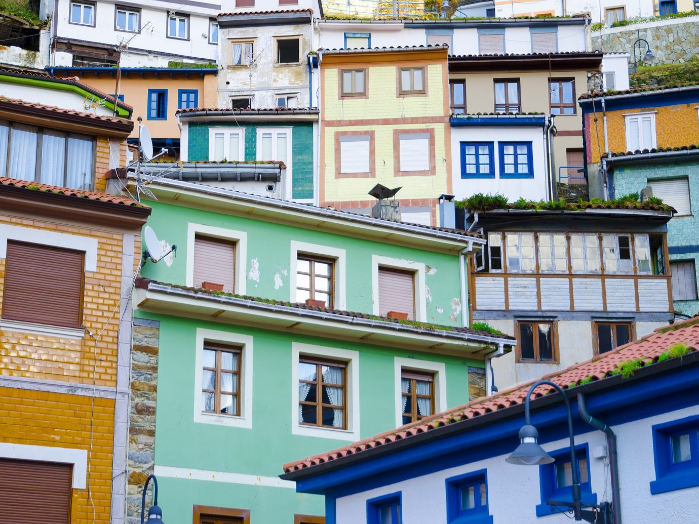 europe Spain Trip Ideas neighbourhood Town building house residential area window Architecture facade City Balcony apartment roof street home real estate mixed use