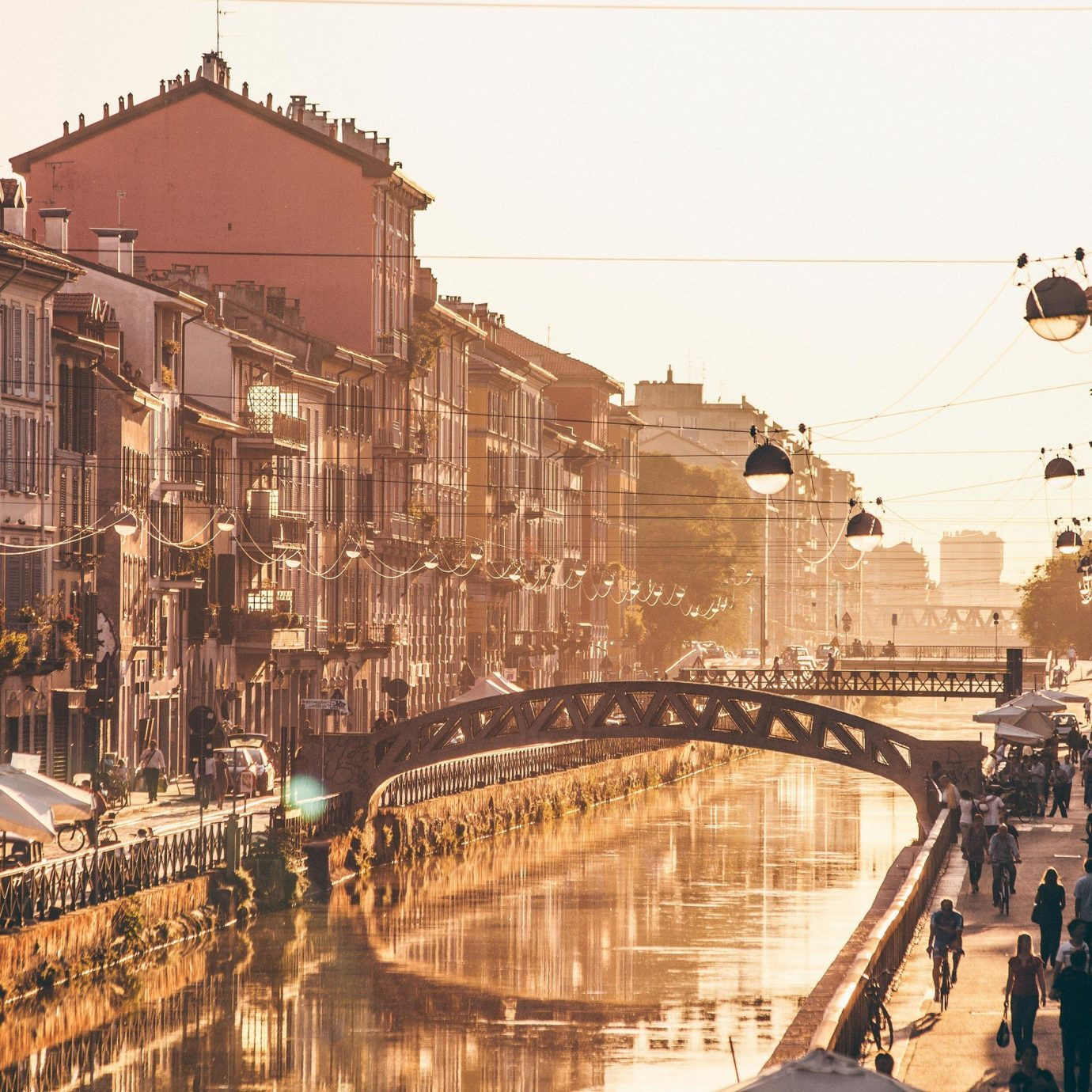 Arts + Culture Italy Milan waterway Town reflection body of water City water urban area Canal sky street neighbourhood cityscape morning evening metropolis building road channel River facade tree