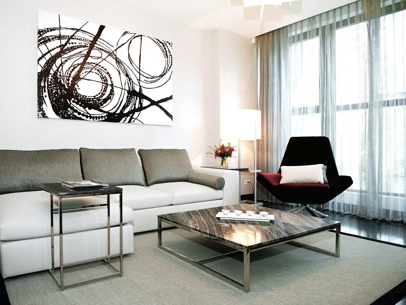Boutique Hotels Chicago Hotels indoor floor room wall Living sofa living room property interior design furniture home Design condominium window covering apartment lamp area leather