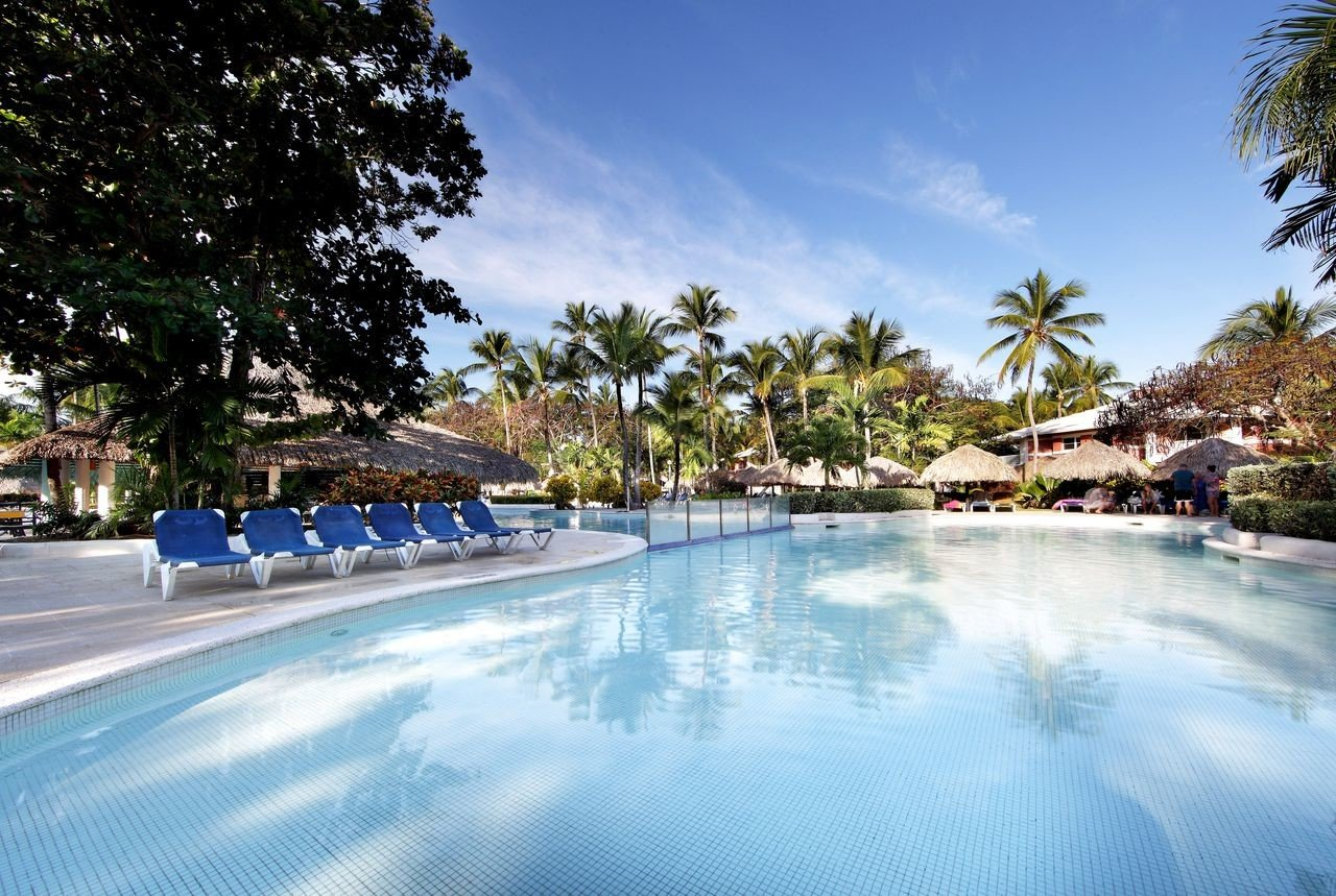 All-Inclusive Resorts caribbean Family Travel Hotels Resort swimming pool water leisure palm tree arecales tree resort town sky reflection vacation tropics real estate tourism estate recreation hotel reflecting pool