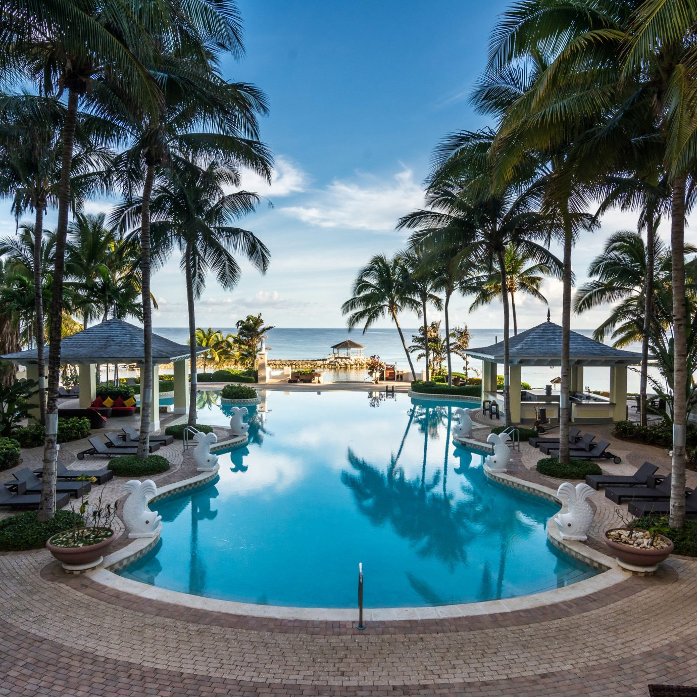 All-Inclusive Resorts Family Travel Hotels Resort property swimming pool palm tree estate leisure arecales real estate condominium home resort town vacation hotel tree tropics Villa water caribbean