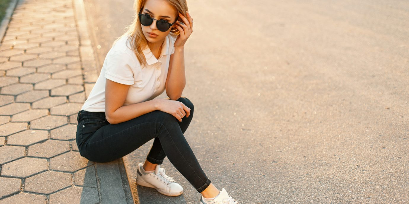 Packing Tips Style + Design Travel Shop ground outdoor person footwear clothing eyewear jeans shoe sunglasses shoulder vision care young girl sitting joint denim glasses trousers neck health & beauty shorts pattern leggings sleeve way