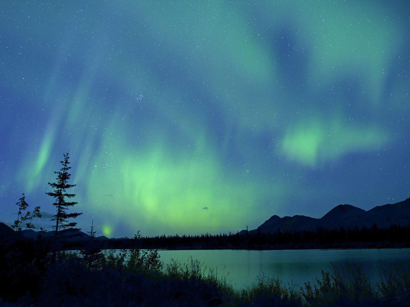 Offbeat Trip Ideas aurora outdoor Nature atmosphere Night Sky