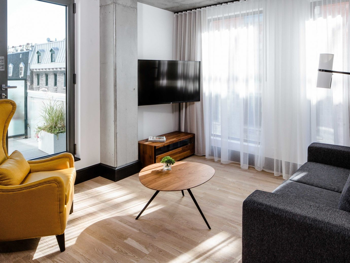 Boutique Hotels Chicago Hotels Living indoor room floor sofa window living room interior design property furniture Suite table chair flooring real estate interior designer angle loft apartment coffee table window treatment hardwood wood flooring area Bedroom decorated leather