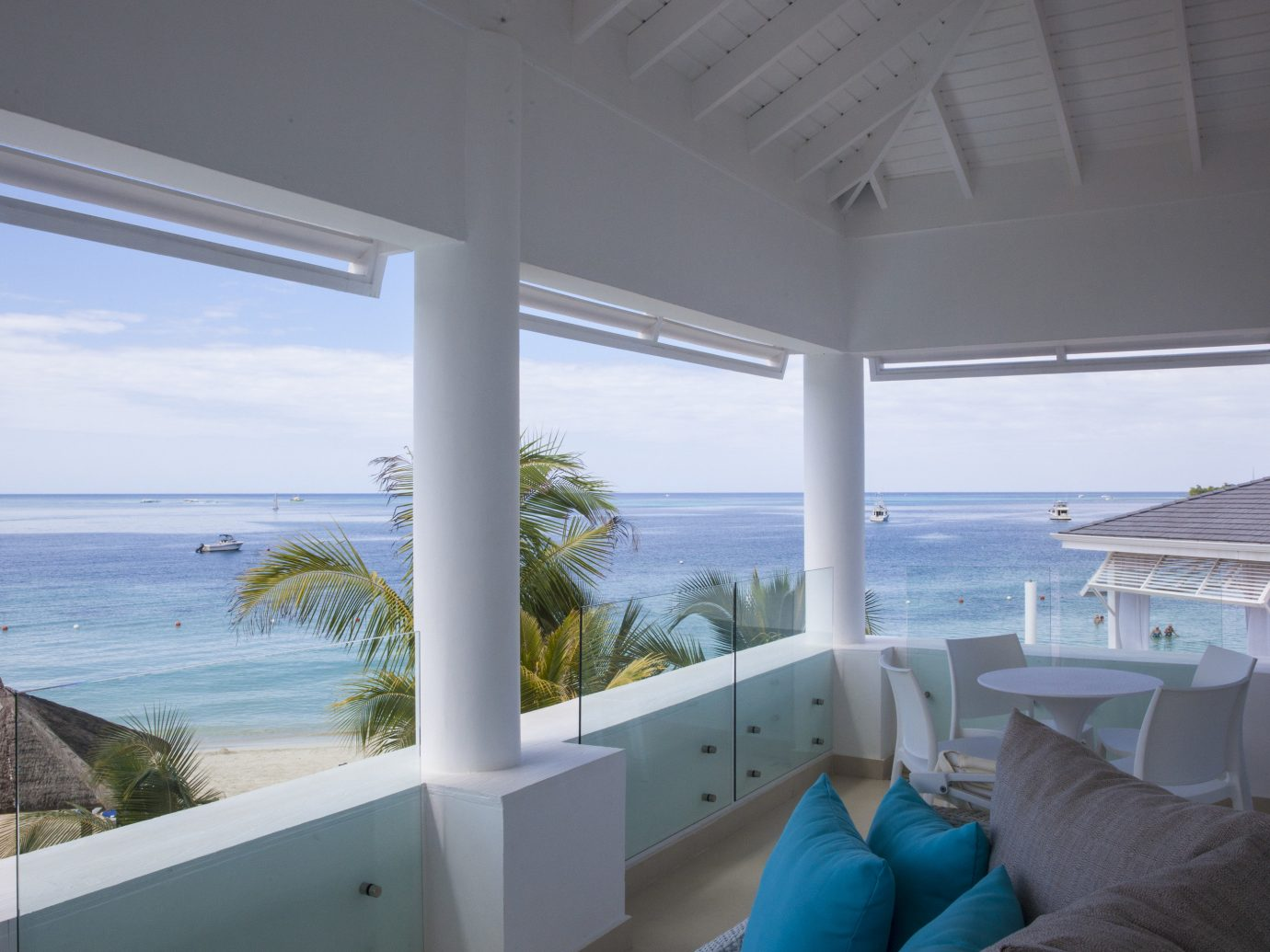 All-Inclusive Resorts Budget Hotels indoor window ceiling property room house Living vacation estate home swimming pool Villa caribbean overlooking condominium interior design real estate furniture apartment Resort cottage Deck porch beautiful