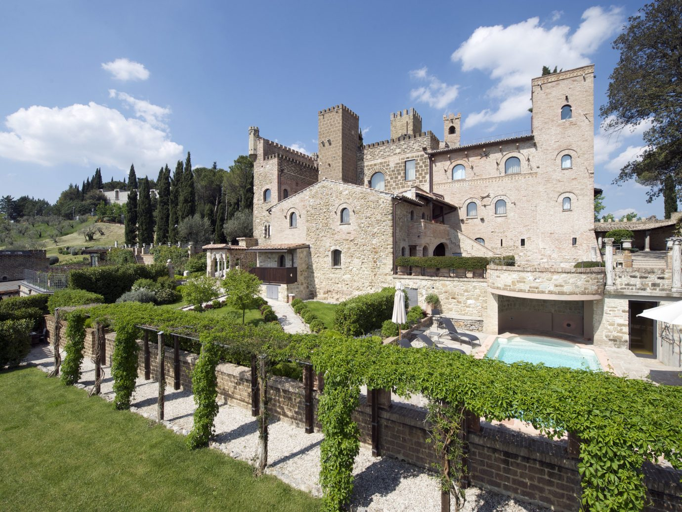 europe Hotels Italy Romance property Village château estate castle building medieval architecture historic site tree Villa sky