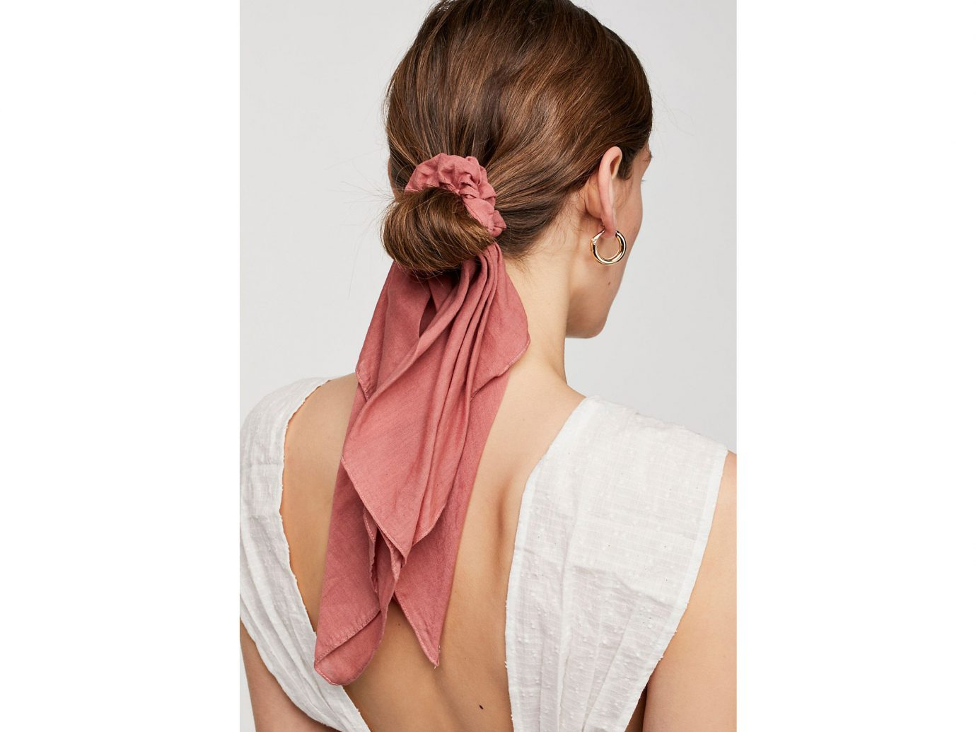 Spring Travel Style + Design Summer Travel Travel Lifestyle Travel Shop person woman hair hairstyle neck shoulder Beauty joint forehead hair accessory hair coloring bun long hair hair tie chignon lady brown hair back ponytail