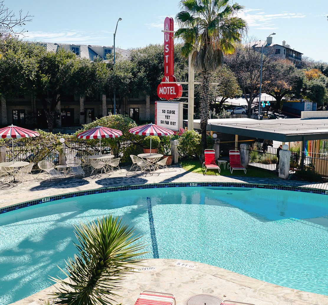 Austin Girls Getaways Texas Trip Ideas Weekend Getaways swimming pool water arecales Resort tree palm tree leisure plant sky vacation tourism recreation outdoor structure real estate