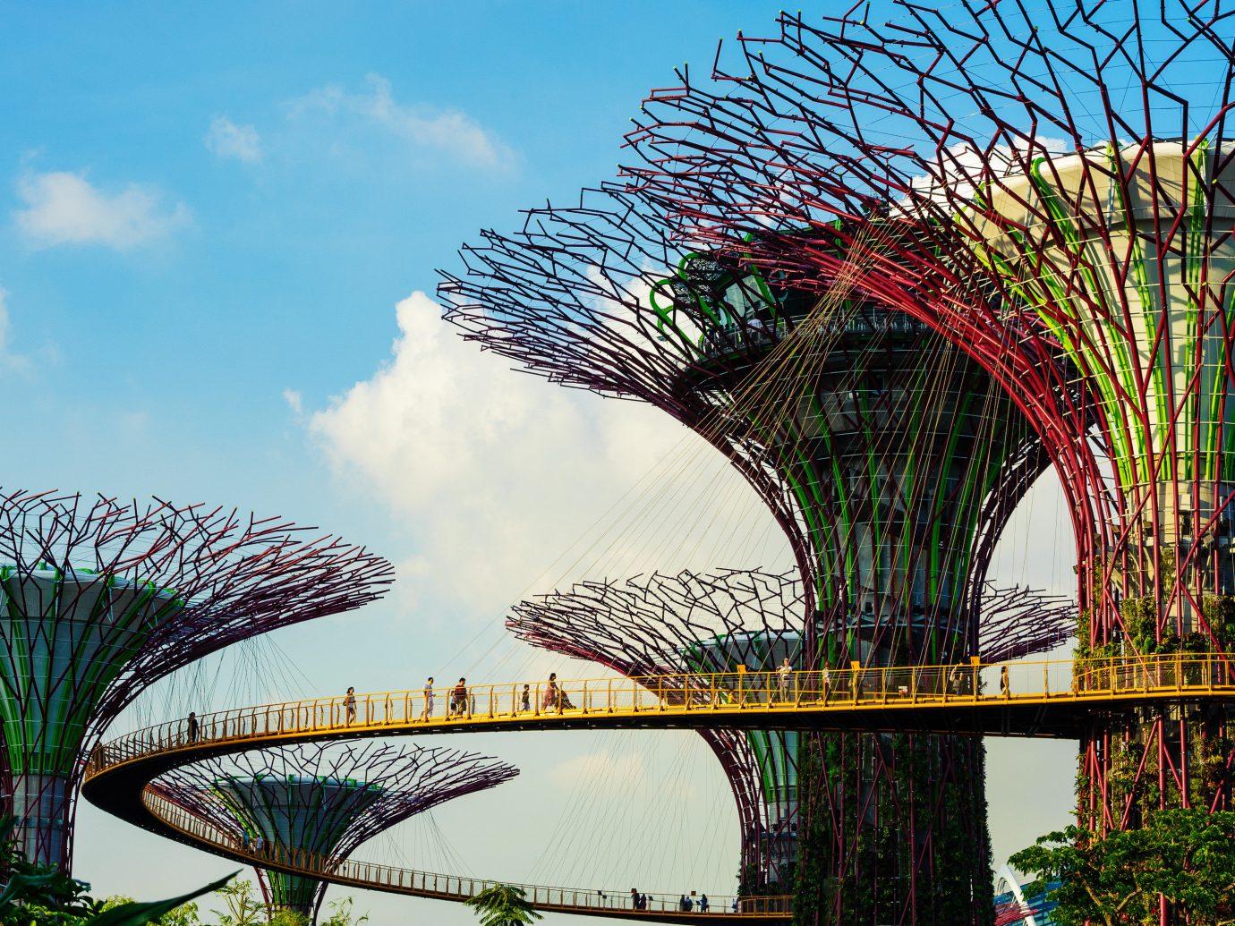 Arts + Culture Singapore Southeast Asia Trip Ideas sky outdoor landmark amusement park building tree bridge botany flower park arecales amusement ride arch cityscape nonbuilding structure Garden plant