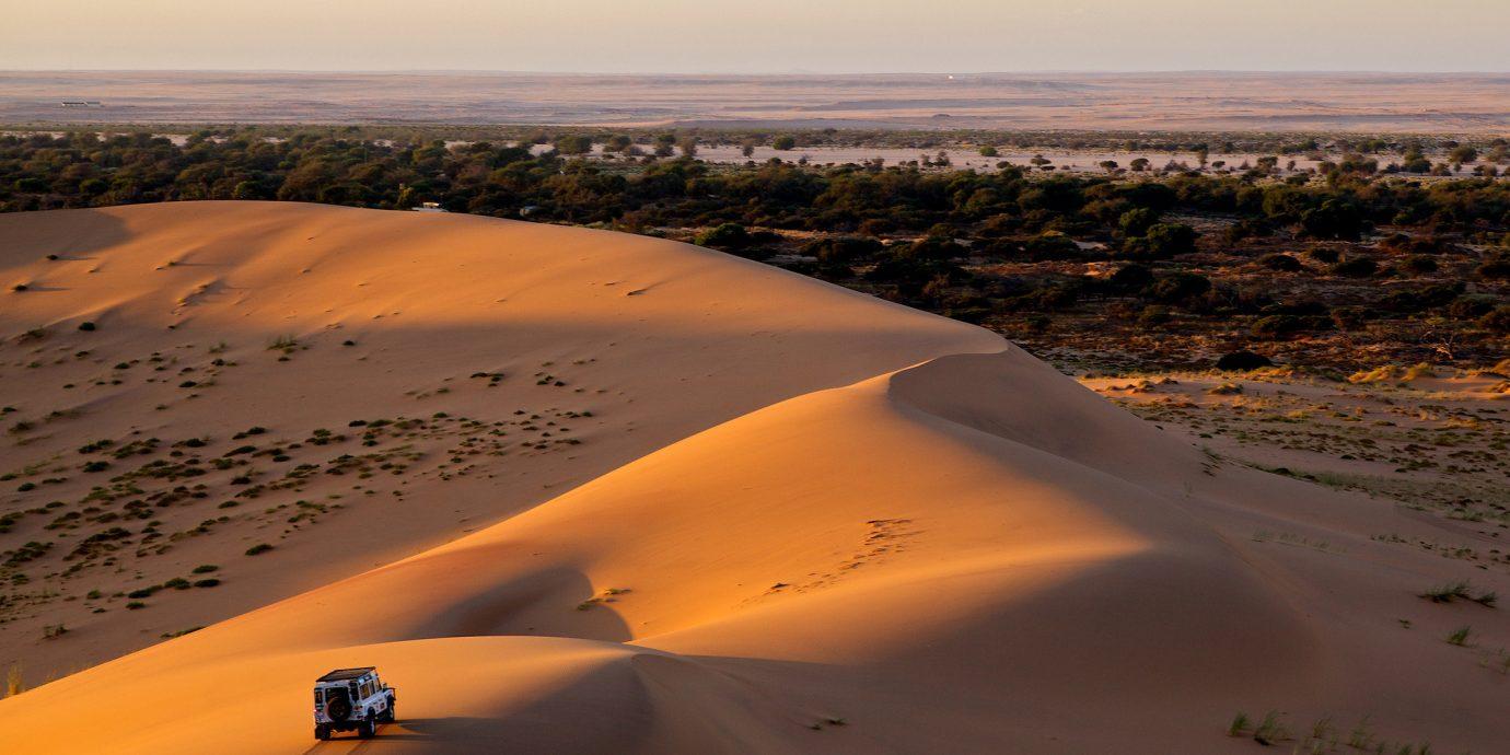 africa Honeymoon Namibia Romance Trip Ideas sky outdoor habitat erg natural environment geographical feature landform Nature aeolian landform Desert ecosystem sahara sand horizon Sunset landscape dune Sea shore wadi material plain