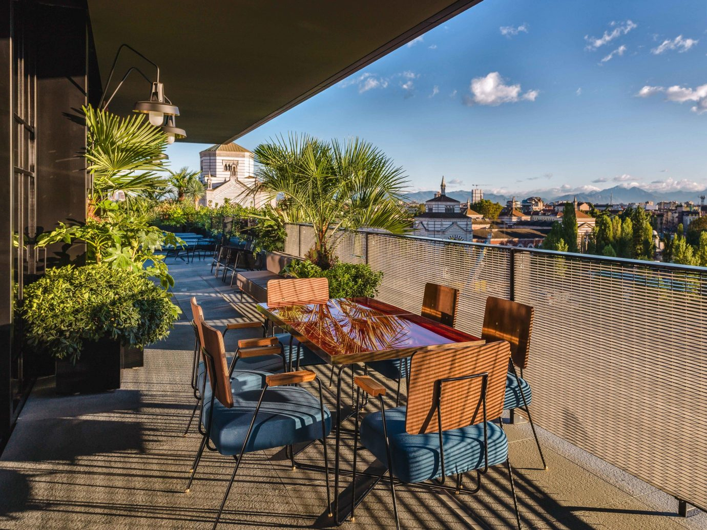 Arts + Culture Italy Milan property real estate Resort home estate Patio outdoor structure roof Balcony apartment walkway leisure tree vacation house penthouse apartment landscape